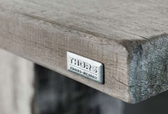 Thors Design logo on a plank table