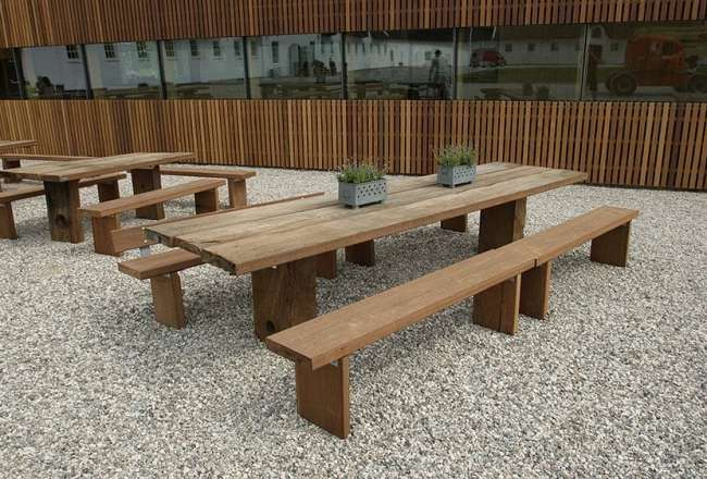 Thors Gaia plank table with plank bench in an outdoor environment