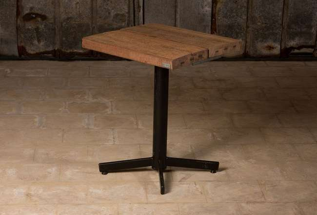 Café table with a rustic (small) surface and self-adjusting legs, black