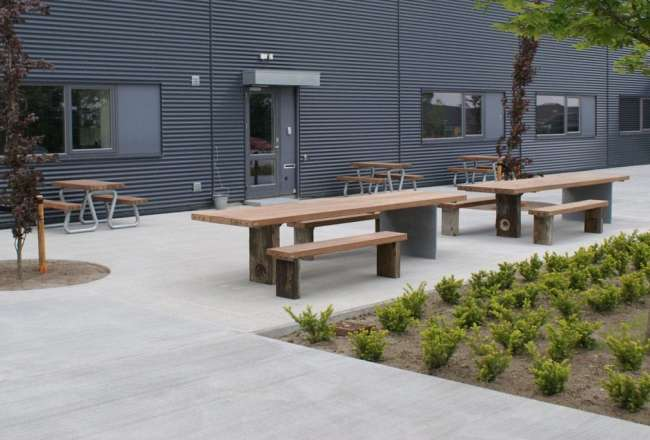 Thors Design Gaia plank tables, plank benches and Omega benches outside A-TEX in Herning