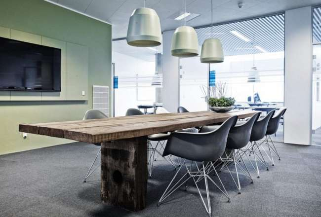 Gaia plank table with rustic surface in a meeting room with Eames Chair