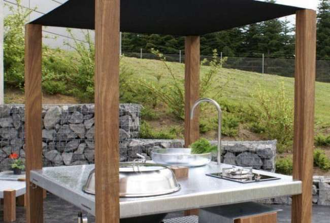Savra island outdoor kitchen with barbeque, gas appliance and sink
