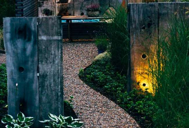 Rustic panels in a garden at night