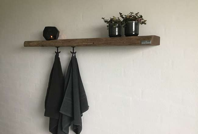 Shelf with hooks in a kitchen