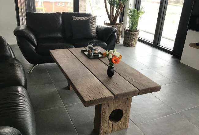 Coffee table with wooden legs in a private livingroom  | Thors Design